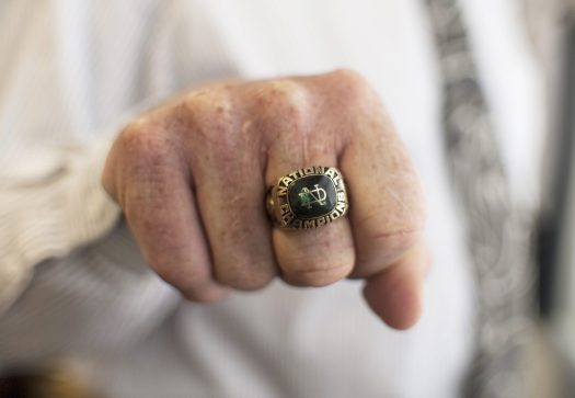 Domin shows his national champion ring. (William Camargo/Staff Photographer)