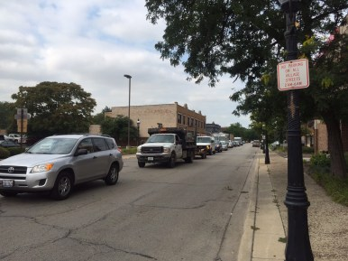 Vehicles back up on East Burlington Street waiting for the long traffic light to change, allowing them to turn north onto Harlem Avenue. (Photo by Bob Uphues)