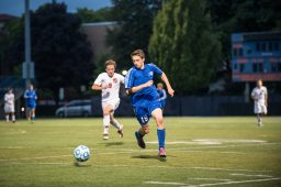 RBHS player Jacob Douglas dribbles the ball up the field against Oak Park and River Forest on August 25. The visiting Bulldogs topped the Huskies 2-1. (Max Herman/Contributing Photographer)