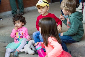 Left to right, Mayabelle, Josh, Artie Cherouny, and Emmaline enjoy French fries from the Boo Coo Roux food truck. | Stacey Rupolo/Contributor