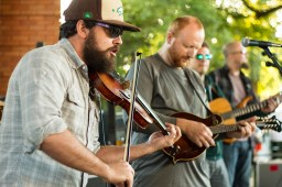 Andy Ohlrich, left, violinist for The Leadfoot Band, performs at HopStop. | Stacey Rupolo/Contributor
