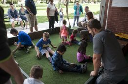 Children interact with turtles. | William Camargo/Staff Photographer