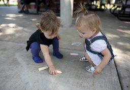 Aria Weissberg and Avery Gordon play with chalk during the Brookfield Fine Arts Festival on Sept. 26. | William Camargo/Staff Photographer
