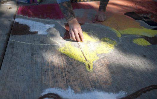 Kevin Rasmussen participates in the sidewalk chalk art contest during the Brookfield Fine Arts Festival on Sept. 26. | William Camargo/Staff Photographer