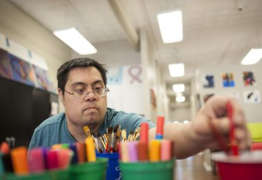 Jason Stuvee paints during an art class at the Community Support Services in Brookfield on Sept. 14. Jason has become a great artist, who also collaborates with other classmates of all ages. | William Camargo/Staff Photographer