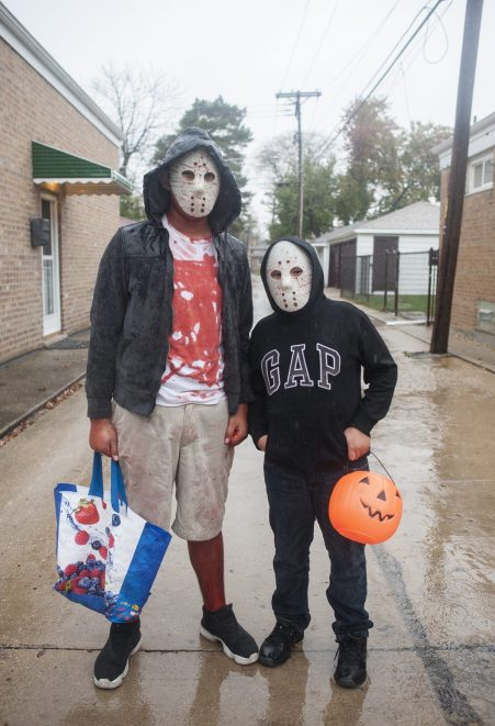 Felipe Estrada and Israel Pacheco pose for a portrait during Halloween in North Riverside on Saturday, Oct. 31.   William Camargo/Staff Photographer