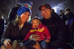 Warming up: The Jackson family warms up by the fire during the Riverside Holiday Stroll, which took place downtown and on Harlem Avenue in December 2014. | File 2014