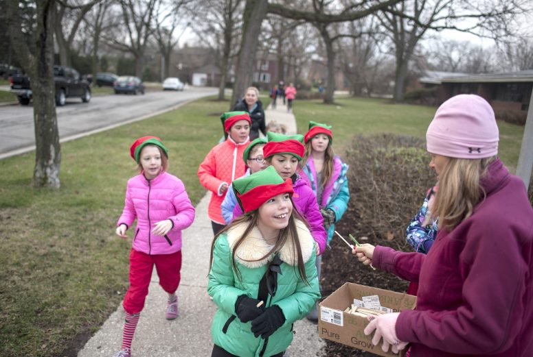 Blythe Park School students collected Popsicle sticks for each lap they completed around the school during the Cocoa Run on Dec. 4. About 55 students participated in the school's Cardio Kids program, which met before school twice a week during the fall. | William Camargo/Staff Photographer