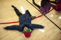 Jay Chazitti stretches before participating in the Cardio Cocoa Run at Blythe Park Elementary. | William Camargo/Staff Photographer