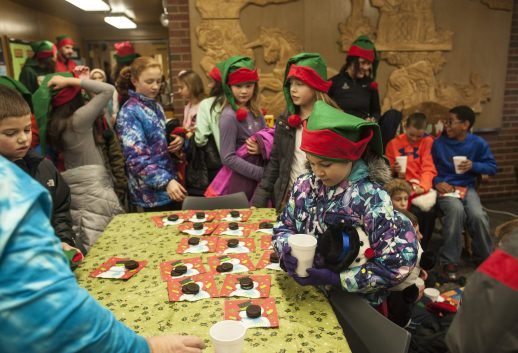 Children enjoy hot cocoa as part of the Cardio Kids Cocoa Run at the Blythe Park Elementary library. | William Camargo/Staff Photographer