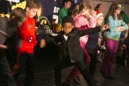 Aden Skinner, age 6 of Matteson, strikes a pose on stage during a dance competition for a scooter at the Brookfield Zoo on New Years Eve.   Rick Majewski/Contributor