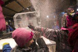 Kids react to a spray ice shavings during an ice sculpting demonstration.   Rick Majewski/Contributor
