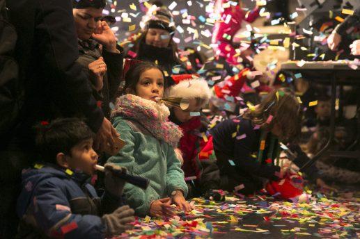 Familys celebrate the coming of 2016 with a confetti canon.   Rick Majewski/Contributor
