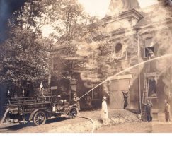 Among the photos discovered in the basement of 8900 Fairview Ave. were several documenting the early years of the Brookfield Fire Department, including an obviously retouched, staged shot from about 1916 of firefighters, with the aid of their brand new fire engine, rescuing a child from the old village hall.