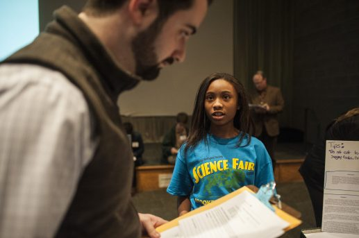 Nora Ford a 6th grader from Komarek Elementary explains her science project during the Brookfield Zoo science fair on Feb. 25. | William Camargo/Staff photography