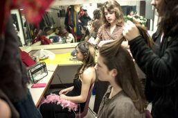 Crew members help student performers get their hair and makeup ready before hitting the stage. | William Camargo/Staff Photographer
