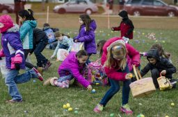 Children rush to pick up plastic eggs that are filled with candy or other surprises. | William Camargo/Staff Photographer