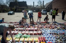 Students from around Riverside and Hauser Junior High School arrange the canned food for the food drive. | William Camargo/Staff Photographer