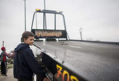 Jayden Karas plays with a towing car during the annual Transportation Exploration Day outside the North Riverside Village Commons on April 28.   William Camargo/Staff Photographer