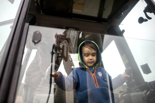 Carmine Boenzi takes the controls of a construction vehicle on display during the annual Transportation Exploration Day outside the North Riverside Village Commons on April 28.   William Camargo/Staff Photographer