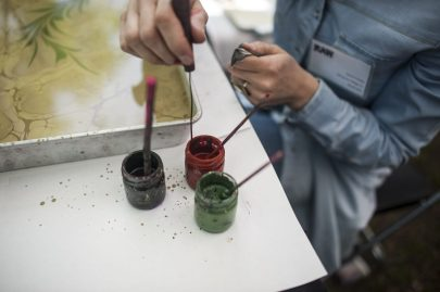 Semi Surucu demonstrates an ancient Turkish art of painting on water. | William Camargo/Staff Photographer