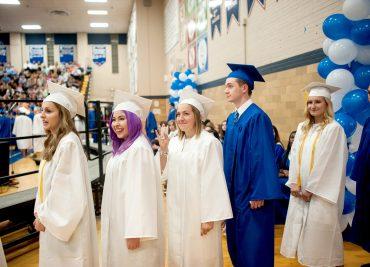 Graduates enter the gymnasium. | William Camargo/Staff Photographer