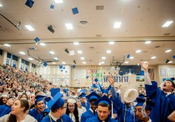 Seniors celebrate by throwing their hats into the air after finalizing their graduation from Riverside Brookfield High School on Friday, May 27. | William Camargo/Staff Photographer