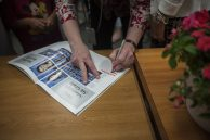 Peg Adamczyk signs a year book during her retiring party. | William Camargo/Staff Photographer
