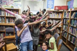 Congress Park students dab as part of the retirement celebration held recently for Adamczyk and Bolen. | William Camargo/Staff Photographer