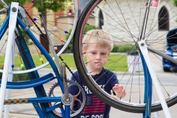 Ari Davis, 4, spins a bicycle wheel with beads on the spokes. | Stacey Rupolo/Contributor