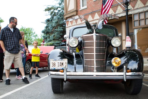 Classic cars line Woodside Road at the first Cruise Night in downtown Riverside. | Stacey Rupolo/Contributor