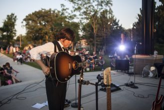 "The band's ""John Lennon"" plugs in for the second set. 