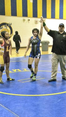 Gracie Garza, center, is the first RBHS female wrestler to qualify for a national championship tournament, the ASICS/Vaughan Junior Freestyle National Wrestling Championship in Fargo, N.D. on July 16. (Courtesy Mike Boyd)