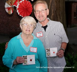 Peg Zak (left) and Frank Pond, another longtime volunteer, show off their service awards from the Wright Trust. | Provided