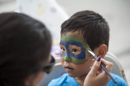T. J. Goodman gets his face painted as a ninja turtle during Riverfest. | William Camargo/Staff Photographer