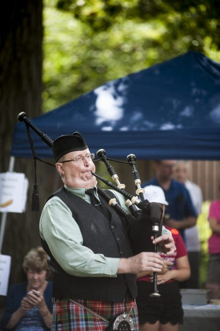 Scott McCawley plays the pipes for the Highlander dancing group during the 100th Annual Scottish Home Picnic in North Riverside on Aug. 6. | William Camargo/Staff Photographer