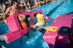Alec Wilkowski's Simpsons-inspired entry proves a little less than seaworthy during the 3rd Annual Cardboard Boat Regatta at the Riverside Swim Club on Sept. 3. | William Camargo/Staff Photographer