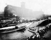 Rescue workers stand atop the hull the Eastland, a Great Lakes pleasure liner that rolled onto its side while passengers were boarding at its Chicago River dock on July 24, 1915. Longtime Hauser music teacher Patty Gill's grandfather, father and two uncles were on board at the time. One of her uncles was killed. | Courtesy of Eastland Disaster Historical Society