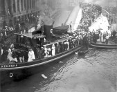 Passengers who were able to clamber onto the side of the Eastland as it listed into the river file off using another boat as a bridge to shore. | Courtesy of Eastland Disaster Historical Society