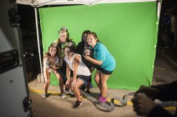 A group of friends take photos as firefighters at a photo booth during Autumn Fest. | William Camargo/Staff Photographer
