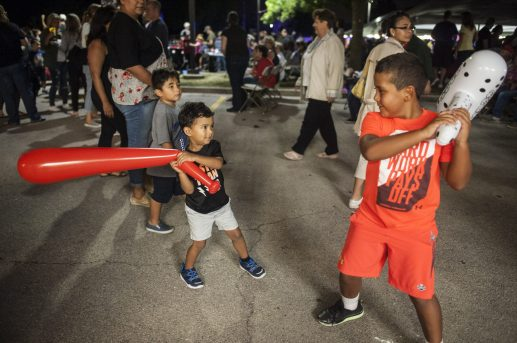 Johnny Louise and Oliver Coia fights with inflatable baseball bats. | William Camargo/Staff Photographer