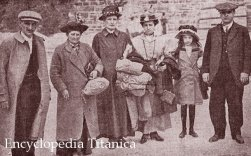 """Edwin """"Tip"""" Martin (far left) after his escape from the sinking ship posed with fellow survivors in Queenstown, Ireland. 