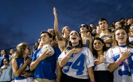 Spectators and Riverside-Brookfield High School Juniors, cover their hearts during the National Anthem.   Sebastian Hidalgo/Contributor