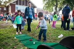 Sebastian Maragay plays mini golf during Fall Fest in Hollywood Elementary in Brookfield on Oct. 15.   William Camargo/Staff Photographer