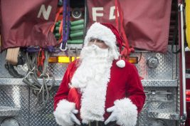 Santa in North Riverside as he made nearly a dozen stops aboard a fire truck during his annual tour. | William Camargo/Staff Photographer