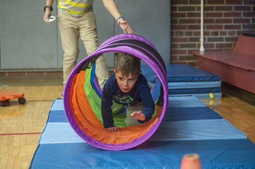 "Valentino Gatti scrambles through a tube that was part of an obstacle course during Blythe Park School's ""One School, One Book"" event on Thursday, March 16. 