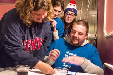 Supporters of the Putting Students First slate in Lyons-Brookfield District 103 flash smiles as vote totals roll in on April 4. The slate swept all three open seats on the school board. | Sebastian Hidalgo/Contributor