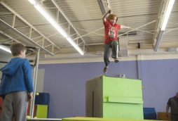 Nick Bacca leaps from a platform at Flipside Academy during a recent class in North Riverside. | William Camargo/Staff Photographer