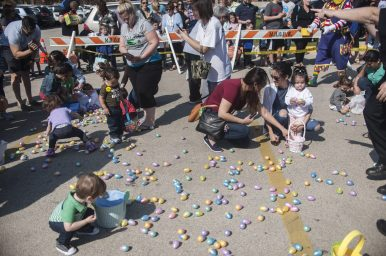 Children with parents collect plastic eggs filled with treats at the North Riverside Policeman's Benevolent and Protective Association's annual Easter Egg Hunt on April 15 in North Riverside. | William Camargo/Staff Photographer