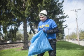 Nicholas Marchese holds a bag full of trash that he picked up around Kiwanis Park in Brookfield during the village's spring Project NICE community cleanup event on April 22. | William Camargo/Staff Photographer